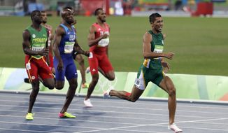 South Africa's Wayde Van Niekerk, right, competes in the men's 400-meter final during the athletics competitions of the 2016 Summer Olympics at the Olympic stadium in Rio de Janeiro, Brazil, Sunday, Aug. 14, 2016. (AP Photo/Natacha Pisarenko)