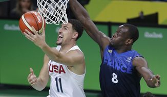 United States' Klay Thompson (11) shoots past France's Charles Kahudi (8) during a men's basketball game at the 2016 Summer Olympics in Rio de Janeiro, Brazil, Sunday, Aug. 14, 2016. (AP Photo/Eric Gay)