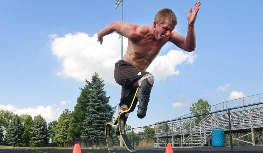 In this Monday, Aug. 1, 2016, photo, paralympian runner A.J. Digby takes off in a full sprint during a workout at the Eastwood High School track in Pemberville, Ohio. He will compete in the 2016 Paralympics in Rio de Janeiro. (Cameron Hart/The Blade via AP)