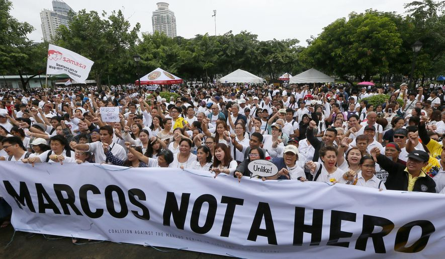 Protesters gather at Rizal Park during a rally to oppose the burial of the late Philippine dictator Ferdinand Marcos at the Heroes' Cemetery in Manila, Philippines, Sunday, Aug. 14, 2016. It was the biggest gathering so far since President Rodrigo Duterte ordered the burial of Marcos with full military honors and with the opposition announcing its plan to file a petition with the Supreme Court. (AP Photo/Bullit Marquez)