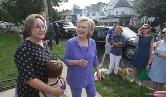 Democratic presidential nominee Hillary Clinton and Vice President Joe Biden (not pictured) stop at Biden's childhood home and talk with neighbors in Scranton, Pa., on Monday, Aug. 15, 2016. On Monday, Clinton and Biden campaigned in Scranton in northeastern Pennsylvania. Clinton is scheduled to campaign in Philadelphia on Tuesday, her second appearance in as many days in the battleground state of Pennsylvania. (Jake Danna Stevens/The Times & Tribune via AP)