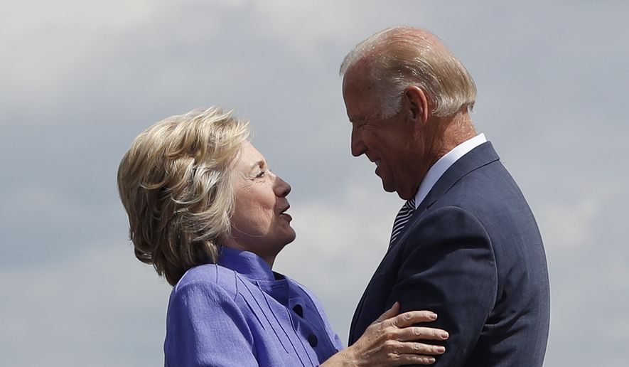 Democratic presidential candidate Hillary Clinton greets Vice President Joe Biden on the tarmac at Wilkes-Barre/Scranton International Airport in Avoca, Pa., Monday, Aug. 15, 2016, before traveling together to a campaign event in Scranton, Pa. (AP Photo/Carolyn Kaster) ** FILE **