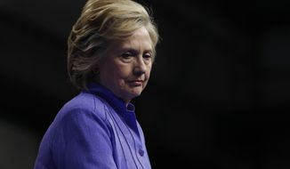 The Justice Department has repeatedly protected Hillary Clinton during her presidential campaign, refusing to pursue charges that she mishandled classified information and fighting an effort to force her to testify under oath in a court case about her emails. (Associated Press)