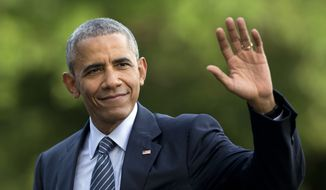 FILE - In this July 5, 2016 photo, President Barack Obama waves as he walks across the South Lawn of the White House, in Washington, as he returns from Charlotte, N.C. where he participated in a campaign event with Democratic presidential candidate Hillary Clinton. Obama is interrupting his summer vacation to do some campaigning for Hillary Clinton, the Democratic presidential nominee. Obama is slated to headline a Democratic Party reception Monday, Aug. 15, 2016, on Martha's Vineyard, the tony Massachusetts island where he's been vacationing with his family. (AP Photo/Carolyn Kaster, File) **FILE**