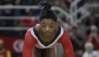 United States' Simone Biles stumbles during her performance on the balance beam during the artistic gymnastics women's apparatus final at the 2016 Summer Olympics in Rio de Janeiro, Brazil, Monday, Aug. 15, 2016. (AP Photo/Julio Cortez)