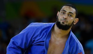 FILE - In this Aug. 12, 2016 photo, Egypt's Islam El Shehaby reacts after losing to Israel's Or Sasson in the men's over 100-kg judo competition at the 2016 Summer Olympics in Rio de Janeiro, Brazil. El Shehaby who refused to shake his Israeli opponent's hand after their judo bout has been reprimanded and sent home from the Rio Olympics, officials said Monday, Aug. 15. (AP Photo/Markus Schreiber, File)