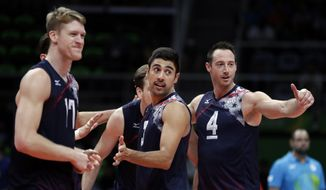United States' Taylor Sander, center, celebrates with teammates Maxwell Holt, left, and David Lee, right, during a men's preliminary volleyball match against Mexico at the 2016 Summer Olympics in Rio de Janeiro, Brazil, Monday, Aug. 15, 2016. (AP Photo/Jeff Roberson)