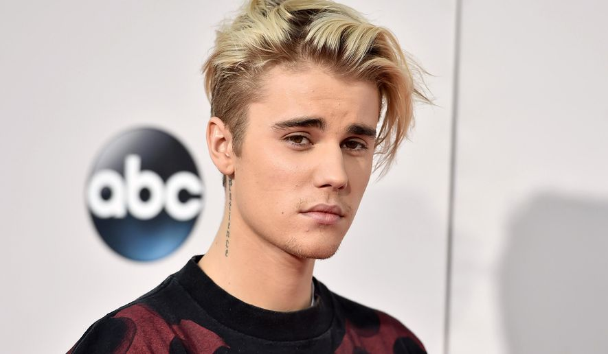 In this Nov. 22, 2015, file photo, Justin Bieber arrives at the American Music Awards at the Microsoft Theater in Los Angeles. Bieber threatened to go private on Instagram in a post on Aug. 13, 2016, after getting negative comments from fans of ex-girlfriend Selena Gomez. (Photo by Jordan Strauss/Invision/AP, File)