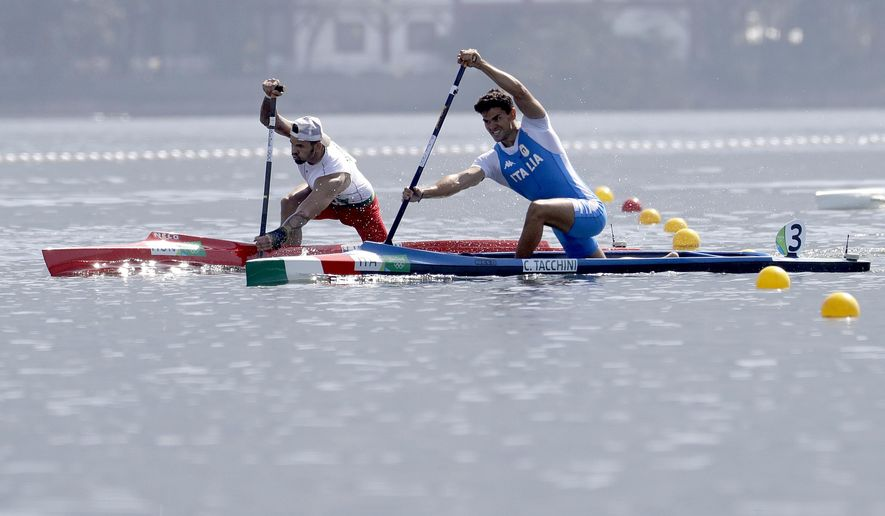 Hungary's Henrik Vasbanyai and Italy's Carlo Tacchini, right, compete in the men's canoe single 1000m semifinal during the 2016 Summer Olympics in Rio de Janeiro, Brazil, Monday, Aug. 15, 2016. (AP Photo/Andre Penner)