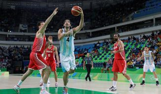 Luis Scola helped beat the U.S. in the Olympics 12 years ago and leads Argentina in Wednesday's quarterfinal rematch. (Associated Press)