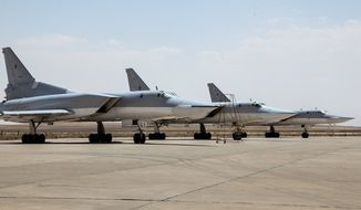 Russian warplanes took off Tuesday from Iran to target Islamic State fighters and other militants in Syria, widening Moscow's bombing campaign against the terrorist army's home base and coordinating with U.S. efforts. (WarfareWW photo via Associated Press)