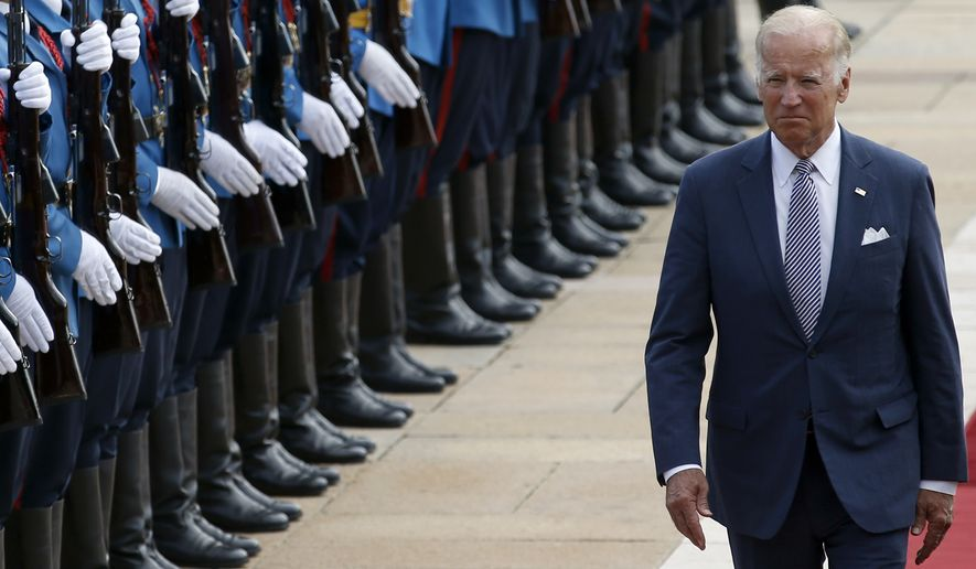 Vice President Joseph R. Biden reviews the honor guard upon his arrival at the Serbia Palace to meet with Prime Minister Aleksandar Vucic in Belgrade on Tuesday. (Associated Press)