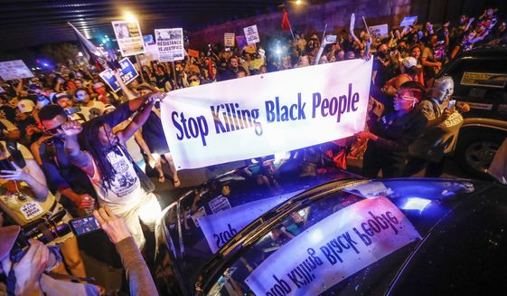 Black Lives Matter demonstrators gather during a protest on Broad Street in Philadelphia on July 26, 2016, during the second day of the Democratic National Convention. (Associated Press)