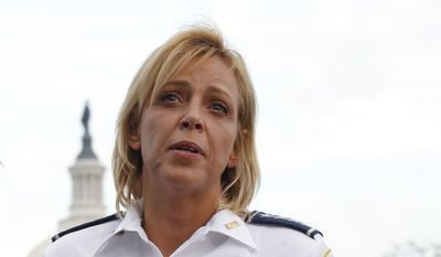 In this Oct. 3, 2013, file photo, Washington Police Chief Cathy Lanier speaks on Capitol Hill in Washington. Lanier is stepping down to become head of security for the National Football League. The police department announced Lanier's departure Tuesday, Aug. 16, 2016, on Twitter. Lanier said in a letter to the department's 3,700 officers that she is taking the job at the NFL.  (AP Photo/Molly Riley, File)