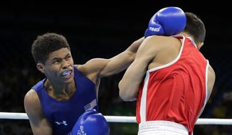 United States' Shakur Stevenson, left, fights Mongolia's Tsendbaatar Erdenebat during a men's bantamweight 56-kg quarterfinals boxing match at the 2016 Summer Olympics in Rio de Janeiro, Brazil, Tuesday, Aug. 16, 2016. (AP Photo/Jae C. Hong)