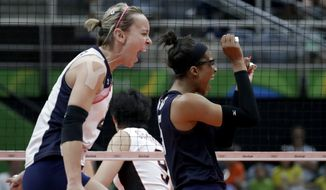 United States' Kayla Banwarth, left, and Rachael Adams celebrate during a women's quarterfinal volleyball match against Japan at the 2016 Summer Olympics in Rio de Janeiro, Brazil, Tuesday, Aug. 16, 2016. (AP Photo/Jeff Roberson)