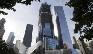 This Monday, Aug. 15, 2016, photo shows the World Trade Center Transportation Hub, lower left, and commercial office buildings 3 World Trade Center, center, and 4 World Trade Center, right, which are part of the rebuilt site, in New York. The Westfield World Trade Center, a retail mall, will open Tuesday, Aug. 16, in the three buildings. (AP Photo/Mark Lennihan)