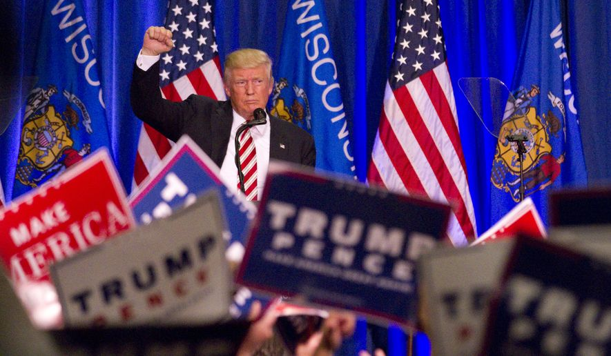 Republican presidential nominee Donald Trump concludes his speech at his campaign rally Tuesday, Aug. 16, 2016 in West Bend, Wis. (John Ehlke/West Bend Daily News via AP)