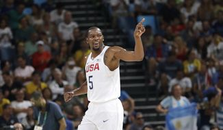 United States' Kevin Durant (5) signals to teammates after he scored against Argentina during a men's quarterfinal round basketball game at the 2016 Summer Olympics in Rio de Janeiro, Brazil, Wednesday, Aug. 17, 2016. (AP Photo/Eric Gay)