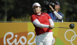 Inbee Park of South Korea, watches her tee shot on the 3rd hole during the first round of the women's golf event at the 2016 Summer Olympics in Rio de Janeiro, Brazil, Wednesday, Aug. 17, 2016. (AP Photo/Chris Carlson)
