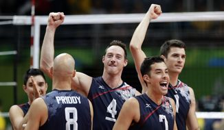 United States' Kawika Shoji (7), celebrates with teammates Matthew Anderson (1), David Lee (4), and William Reid Priddy (8) after defeating Poland in a men's quarterfinal volleyball match at the 2016 Summer Olympics in Rio de Janeiro, Brazil, Wednesday, Aug. 17, 2016. (AP Photo/Robert F. Bukaty)