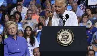 Democratic presidential candidate Hillary Clinton listens, left, listens as Vice President Joe Biden addresses a gathering at a campaign rally Monday, Aug. 15, 2016, in Scranton, Pa. (AP Photo/Mel Evans)