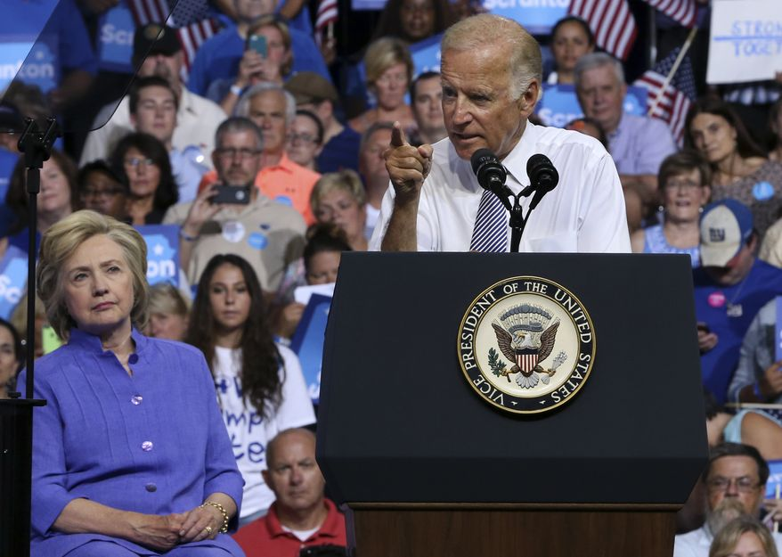 Democratic presidential candidate Hillary Clinton listens, left, listens as Vice President Joe Biden addresses a gathering at a campaign rally Monday, Aug. 15, 2016, in Scranton, Pa. (AP Photo/Mel Evans)  **FILE**