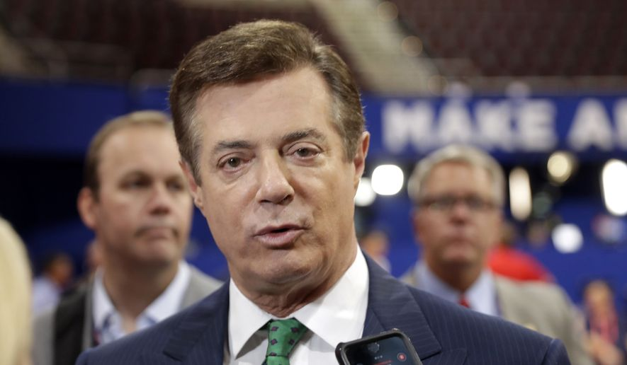 FILE - In this July 17, 2016 file photo, Trump Campaign Chairman Paul Manafort talks to reporters on the floor of the Republican National Convention at Quicken Loans Arena, Sunday, in Cleveland.  (AP Photo/Matt Rourke, File) **FILE**