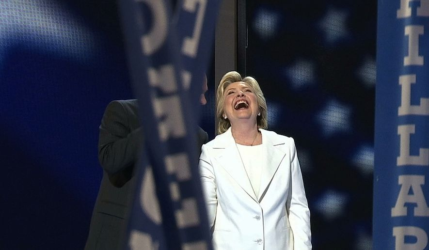 Democratic presidential nominee Hillary Clinton celebrates at the Wells Fargo Center in Philadelphia on the final night of the Democratic National Convention, July 28, 2016. (AP Photo/Alex Sanz)
