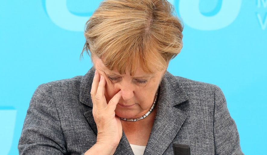 """German Chancellor Angela Merkel, who supports sanctions against Russia, is unlikely to lose elections next month, but the nation's domestic intelligence agency says Moscow can be expected to settle for shenanigans that weaken the public's """"faith in democracy."""" (Associated Press/File)"""