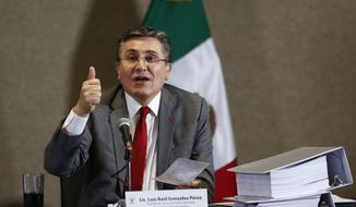 National Human Rights Commission President Luis Raul Gonzalez Perez speaks during the presentation of a report about human rights abuses by Mexico's federal police, in Mexico City, Aug. 18, 2016. Gonzalez said that Mexico's federal police arbitrarily executed 22 people on May 22, 2015, at a ranch in the western state of Michoacan. (AP Photo/Moises Castillo) ** FILE **