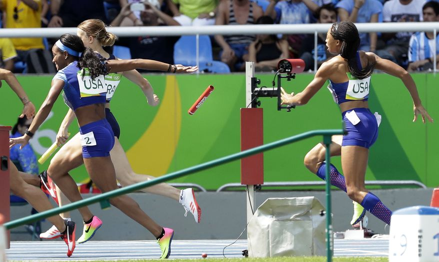 English Gardner and Allyson Felix, right, from the United States drop the baton in a women's 4x100-meter relay heat during the athletics competitions of the 2016 Summer Olympics at the Olympic stadium in Rio de Janeiro, Brazil, Thursday, Aug. 18, 2016. (AP Photo/Matt Dunham)
