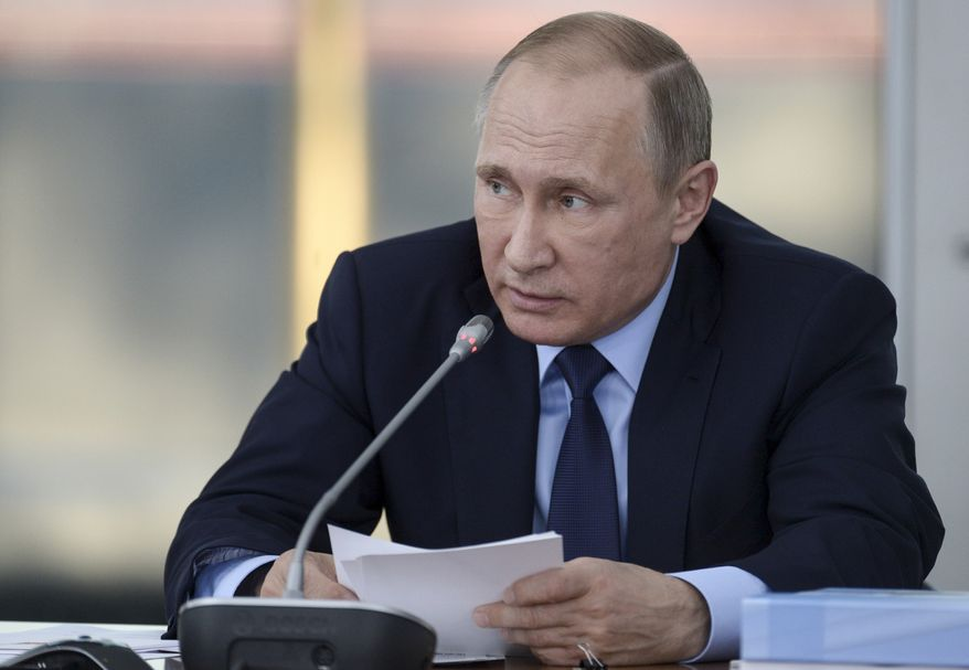 Russian President Vladimir Putin also is building up forces on the Ukraine border and setting up military posts in the Arctic. (Associated Press)