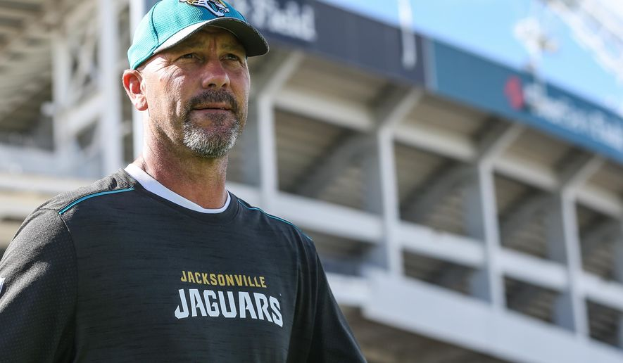 Jacksonville Jaguar head coach Gus Bradley walks onto the field for an NFL football joint training camp with the Tampa Bay Buccaneers at Florida Blue Field in Jacksonville, Fla., Wednesday, Aug. 17, 2016. (The Florida Times-Union, Gary McCullough)