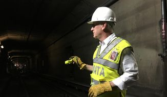 Metro General Manager Paul Wiedefeld inspected maintenance work in a tunnel on Metro's Orange Line in July. (Associated Press)