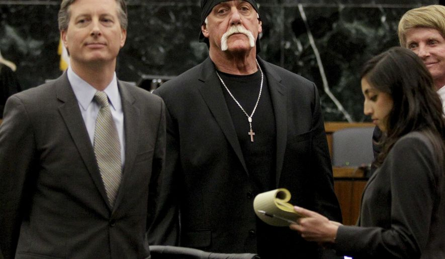 FILE - In this Monday, March 21, 2016, file photo, Hulk Hogan, whose given name is Terry Bollea, center, looks on in court moments after a jury returned its decision in St. Petersburg, Fla. Hogan sued Gawker for invasion of privacy and, bankrolled by tech billionaire Peter Thiel, won a $140 million judgment that led to Gawker's bankruptcy filing. Gawker.com is going to shut down as its parent company is sold to Univision, a reporter for the 14-year-old site said Thursday, Aug. 18, 2016. (Dirk Shadd/The Tampa Bay Times via AP, Pool, File)
