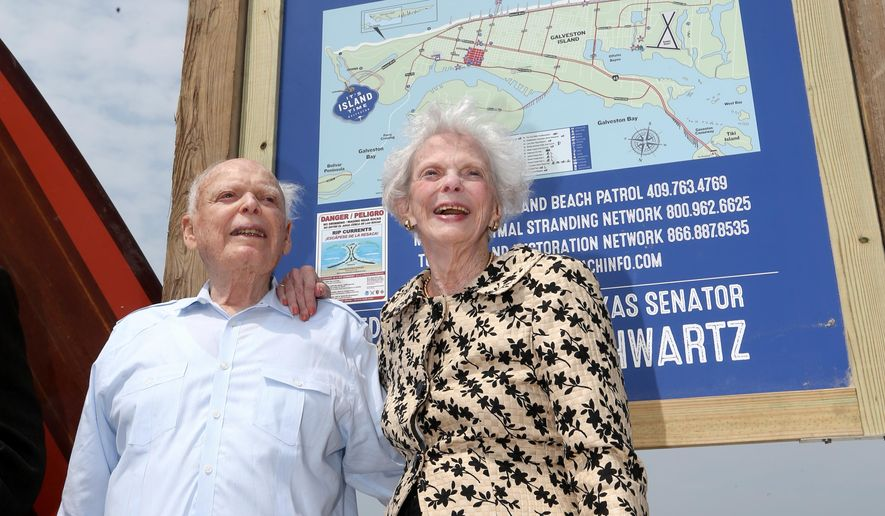 "Former Texas Senator A.R. ""Babe"" Schwartz and his wife, Marilyn, pose for photos Thursday, May 26, 2016, during the dedication of Babe's Beach in Galveston, Texas. Schwartz is working to find ways for the Galveston Park Board to cooperate with other beach communities to restore money taken away by the Legislature in 2015. He believes access to public beaches has been under constant assault since the day the Open Beaches Act was enacted in 1959.  (Jennifer Reynolds/The Galveston County Daily News via AP)"