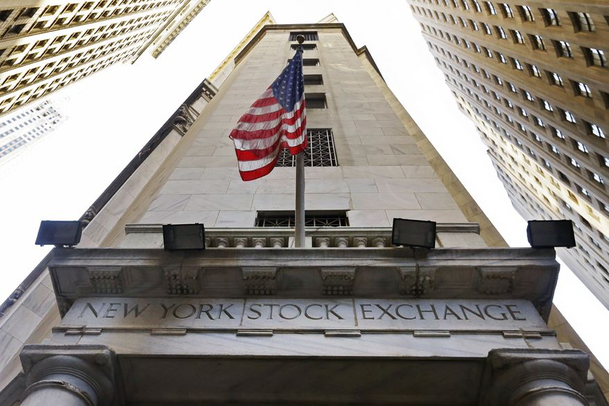 FILE - In this Friday, Nov. 13, 2015, file photo, the American flag flies above the Wall Street entrance to the New York Stock Exchange. U.S. stocks slipped early Tuesday, Aug. 16, 2016, as investors continued to sell phone company and utility stocks. Materials companies are the exception, as theyre trading higher as the dollar weakens. Investors are also sifting through reports that showed inflation remained weak in July, but home building and factory production improved. (AP Photo/Richard Drew, File)