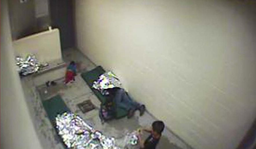This September 2015 image made from U.S. Border Patrol surveillance video shows a child crawling on the concrete floor   near the bathroom area of a holding cell, and a woman and children wrapped in Mylar sheets at a U.S. Customs and Border Protection station in Douglas, Ariz. On Wednesday, Aug. 17, 2016, this and other images were filed as evidence in a lawsuit against the U.S. Border Patrol citing poor conditions in Arizona holding facilities. (U.S. Border Patrol via AP)