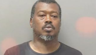 "Clarence Eugene Reed (pictured here), 47, and Jennifer Diane Denen, 30, were charged Friday after allegedly zip-tying a 4-year-old girl to furniture as punishment and verbally abusing her to the point that she believed her name was ""idiot,"" police said. (Hot Springs Police Department via KARK)"