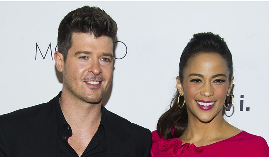 """Robin Thicke first met actress Paula Patton in 1991 at an under-21 hip-hop club on the Sunset Strip in Los Angeles, when he asked her to dance. According to Thicke, he sang Stevie Wonder's """"Jungle Fever"""" to her as they danced. Thicke began dating Patton at the age of 16. They were married in 2005, and have a son, Julian Fuego Thicke, born in 2010. Thicke and Patton separated in February 2014, after 21 years together and almost nine years of marriage. On October 9, 2014, Paula Patton officially filed for divorce. The divorce was finalized on March 20, 2015. (AP Photo)"""