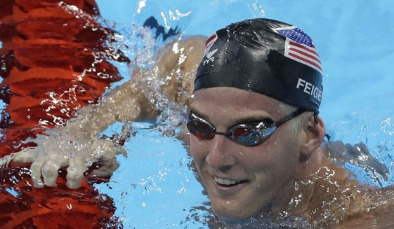 In this Aug. 2, 2016, file photo, United States James Feigen smiles during a swimming training session prior to the 2016 Summer Olympics in Rio de Janeiro, Brazil. Feigen was one of four American Olympic swimmers in connection to a story of being held at gunpoint and robbed several hours after the last Olympic swimming races ended. That claim began to unravel when police said that investigators could not find evidence to substantiate it. (AP Photo/Matt Slocum, File)