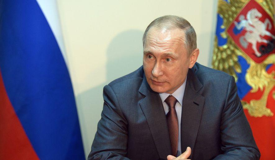 Russian President Vladimir Putin. **File (Alexei Nikolsky/Sputnik, Kremlin Pool Photo via AP)