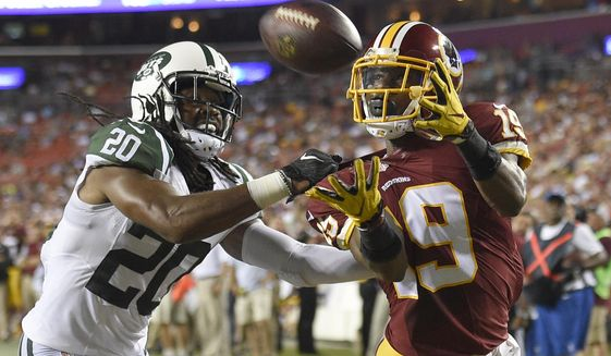 New York Jets cornerback Marcus Williams (20) can't stop a touchdown catch by Washington Redskins wide receiver Rashad Ross (19) during the first half of an NFL preseason football game Friday, Aug. 19, 2016, in Landover, Md. (AP Photo/Nick Wass) ** FILE **