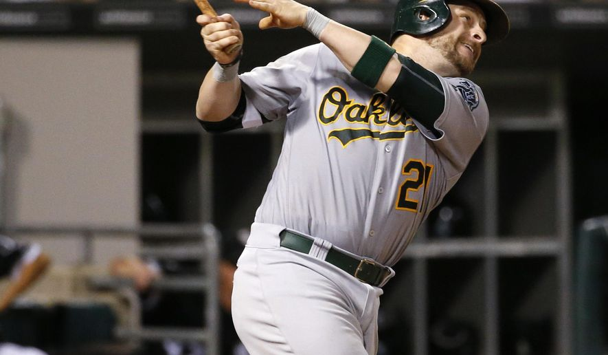 Oakland Athletics' Stephen Vogt hits a one-run double during the sixth inning of a baseball game against the Chicago White Sox in Chicago, Friday, Aug. 19, 2016. (AP Photo/Nam Y. Huh)