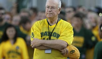 "FILE - In the Sept. 12, 2015, file photo, Baylor President Ken Starr waits to run onto the field before an NCAA college football game in Waco, Texas. The former Baylor president is resigning his post as a law school professor, severing ties with the faith-based campus still reeling from a sexual assault scandal. Baylor said in a statement Friday, Aug. 19, 2016, that Starr ""will be leaving his faculty status and tenure"" in a separation that was mutually agreed upon.  (AP Photo/LM Otero, File)"