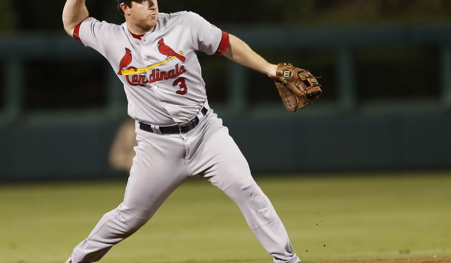 St. Louis Cardinals shortstop Jedd Gyorko (3) throws to first baseman Matt Carpenter for an out against  Philadelphia Phillies' Aaron Altherr in the third inning inning of a baseball game, Friday, Aug. 19, 2016, in Philadelphia. (AP Photo/Laurence Kesterson)