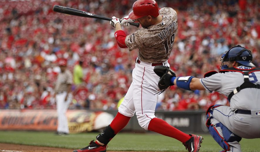 Cincinnati Reds' Joey Votto swings on a three-run home run off Los Angeles Dodgers starting pitcher Bud Norris during the first inning of a baseball game Friday, Aug. 19, 2016, in Cincinnati. (AP Photo/Gary Landers)