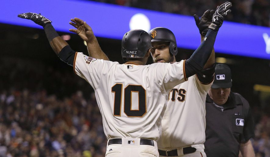 San Francisco Giants' Madison Bumgarner, rear, is greeted at home plate by Eduardo Nunez after hitting a two-run home run off New York Mets starting pitcher Jacob deGrom during the fourth inning of a baseball game Thursday, Aug. 18, 2016, in San Francisco. (AP Photo/Eric Risberg)