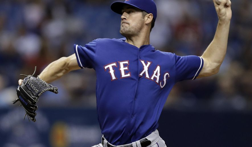 Texas Rangers starting pitcher Cole Hamels delivers to the Tampa Bay Rays during the fourth inning of a baseball game Friday, Aug. 19, 2016, in St. Petersburg, Fla. (AP Photo/Chris O'Meara)